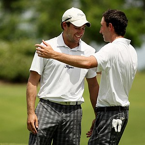 Senior Taylor Hall of Georgetown is greeted by teammate Brian Dorfman, also a senior, after they finished the final round of the Big East Men's Championship at Reunion Resort. Georgetown finished 5th for the tournament.