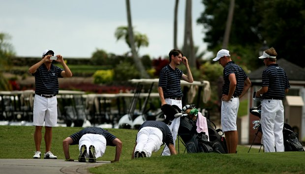 Villanova's head coach James Wilkes and assistant Brian Heffernan do push ups for the birdies made during the final round of the Big East Men's Championship. The coaches did 10 push ups for each birdie made. Villanova players combined for 13 birdies in the final round placing third in the event.