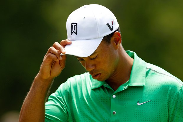 Tiger Woods reacts after putting on the ninth green to finish his second round of the Wells Fargo Championship at the Quail Hollow Club.