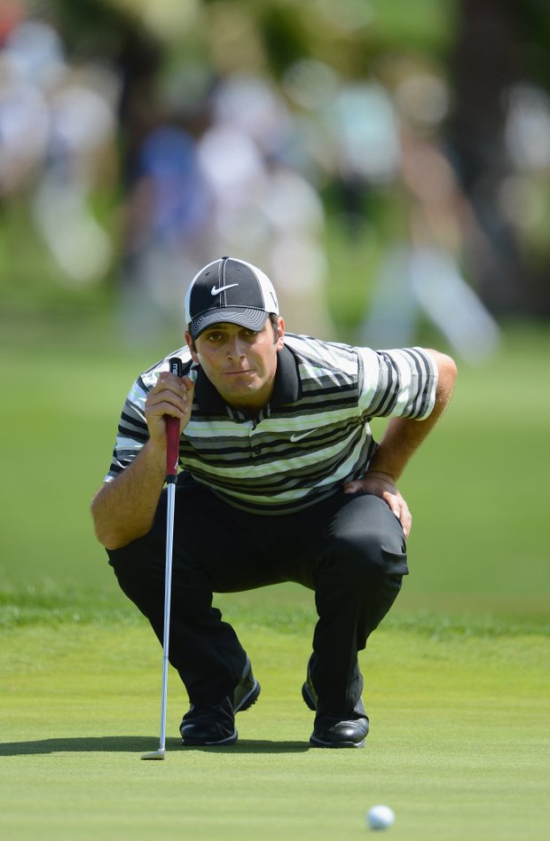 Francesco Molinari lines up a putt during the final round of the Open de Espana at Real Club de Golf de Sevilla.