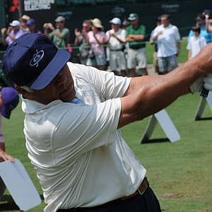 Lee Trevino hits a few balls after the conclusion of play at the Houston Greats of Golf Challenge..