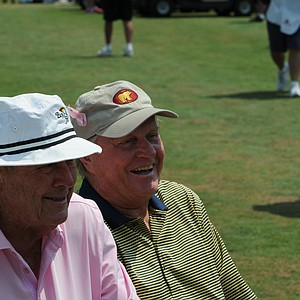 Jack Nicklaus and Arnold Palmer share a little inside joke at the Houston Greats of Golf Challenge..