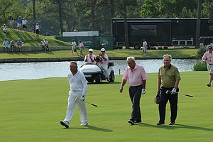 The winners - Jack Nicklaus, Gary Player and Arnold Palmer - walk up the 18th at the Houston Greats of Golf Challenge.
