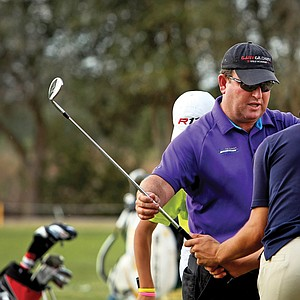 Gary Gilchrist works with a student on the range at Mission Inn in Howey-in-the-Hills, Fla., home of his own junior golf academy.