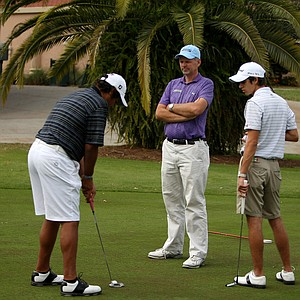 Golf instructor Scott Gump with Gonzo Rubio, 18, and Jose Hernandez, 17, at Mission Inn.