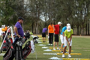Gary Gilchrist watches students hit balls on the range at Mission Inn.