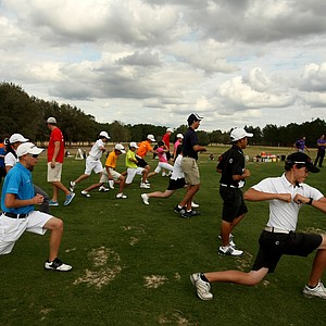 Students stretch on the back of the range at Mission Inn.