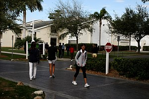 Students walk through the IMG Academies campus.