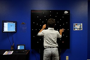 Mateo Botero Lopez works on his reaction time and accuracy skills with the Dynavision Board in the Vision Testing Center at IMG Acadamies.