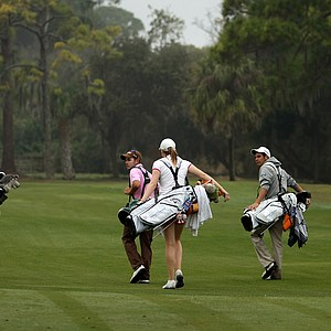 IMG students play a round of golf in a college format at IMG Golf and Country Club.