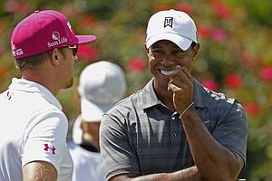 Tiger Woods, right, and Hunter Mahan, laugh on the 18th tee during the first round of the Players Championship golf tournament, Thursday, May 10, 2012, at Sawgrass in Ponte Vedra Beach, Fla.