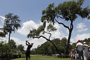 Tiger Woods hits from the sixth tee during the first round of the Players Championship golf tournament, Thursday, May 10, 2012, at TPC Sawgrass in Ponte Vedra Beach, Fla.