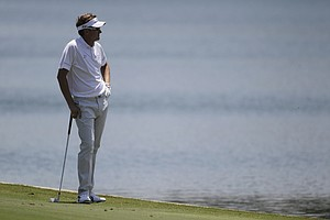 Ian Poulter waits is turn on the 18th fairway during the first round of the Players Championship golf tournament, Thursday, May 10, 2012, at Sawgrass in Ponte Vedra Beach, Fla.