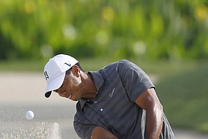 Tiger Woods hits from an 11th hole bunker during the first round of the Players Championship golf tournament, Thursday, May 10, 2012, at Sawgrass in Ponte Vedra, Fla.