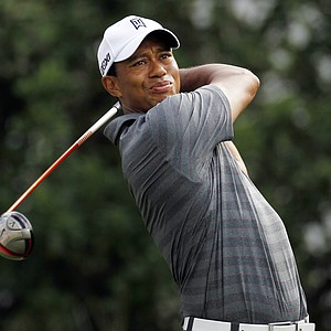 Tiger Woods hits from the 11th tee during the first round of the Players Championship golf tournament, Thursday, May 10, 2012, at Sawgrass in Ponte Vedra, Fla.