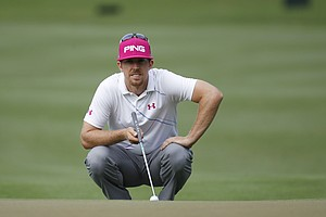 Hunter Mahan views his shot from the 10th green during the first round of the Players Championship golf tournament, Thursday, May 10, 2012, at Sawgrass in Ponte Vedra, Fla.