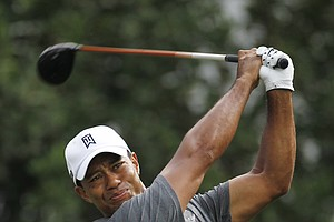 Tiger Woods hits from the 1th tee during the first round of the Players Championship golf tournament, Thursday, May 10, 2012, at Sawgrass in Ponte Vedra, Fla.