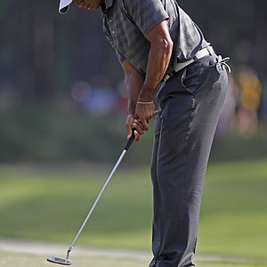 Tiger Woods putts on the 11th green during the first round of the Players Championship golf tournament, Thursday, May 10, 2012, at Sawgrass in Ponte Vedra, Fla.