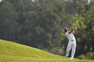 Rickie Fowler hits from the 14th hole fairway during the first round of the Players Championship golf tournament, Thursday, May 10, 2012, at Sawgrass in Ponte Vedra, Fla.