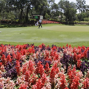 Harrison Frazar, center, and Justin Leonard, left, walk up to the 13th green during the first round of the Players Championship golf tournament, Thursday, May 10, 2012, at TPC Sawgrass in Ponte Vedra, Fla.