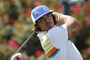 Rickie Fowler hits from the 18th tee during the first round of the Players Championship golf tournament, Thursday, May 10, 2012, at Sawgrass in Ponte Vedra Beach, Fla.