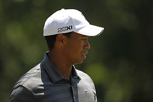 Tiger Woods looks at his putt on the 8th green during the first round of the Players Championship golf tournament, Thursday, May 10, 2012, at Sawgrass in Ponte Vedra Beach, Fla.
