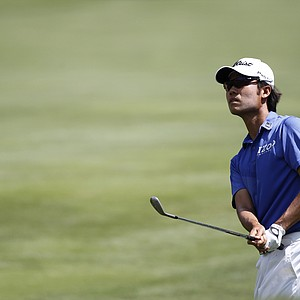 Kevin Na watches his shot from the 18th fairway during the first round of the Players Championship golf tournament, Thursday, May 10, 2012, at Sawgrass in Ponte Vedra Beach, Fla.