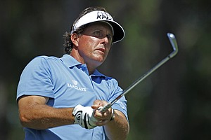 Phil Mickelson watches his shot from the sixth tee during the first round of the Players Championship golf tournament, Thursday, May 10, 2012, at TPC Sawgrass in Ponte Vedra Beach, Fla.