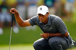 Tiger Woods lines up a putt on the 13th hole of TPC Sawgrass' Stadium Course during the first round of The Players Championship in Ponte Vedra Beach, Fla. Woods shot 2-over 74.