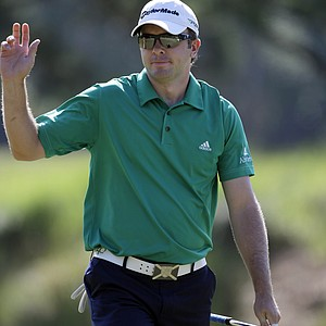 Martin Laird, of Scotland, acknowledges the crowd after making par on the sixth hole during the second round of the Players Championship.