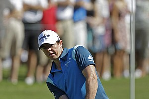 Rory McIlroy, of Northern Ireland, watches his chip to the 14th green during the second round of the Players Championship.