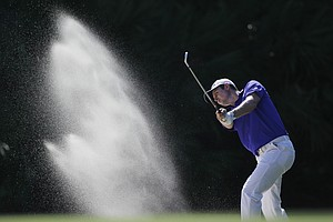 Justin Rose, of England, hits from a 15th hole bunker during the second round of the Players Championship.