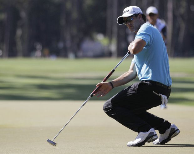 Adam Scott of Australia reacts after he missed a putt on the 15th hole during the second round of the Players Championship.