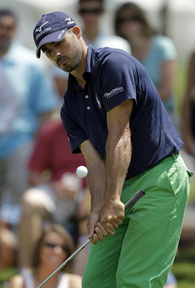Jonathan Byrd chips to the fifth green during the second round of the Players Championship.