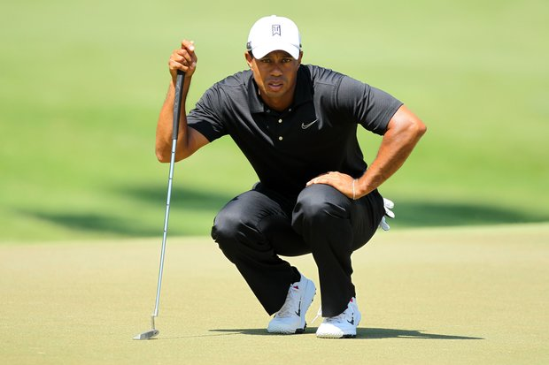Tiger Woods of the United States lines up his putt on the sixth hole during the second round of THE PLAYERS Championship.