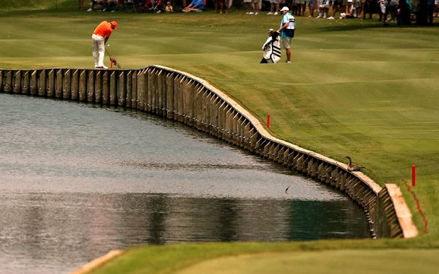 Sergio Garcia hits from near the water at No. 18 on Saturday at The Players Championship at TPC Sawgrass. Garcia posted a 68 on Saturday.
