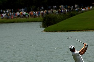 Robert Karlsson is silhouetted at No. 18 as he hits his third shot on Saturday at The Players Championship at TPC Sawgrass. Karlsson bogeyed the hole.