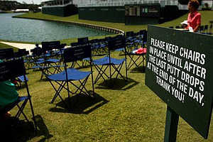 "About 250 chairs are placed at ""The Bluff"" around 18th green during the tournament at The Players Championship at TPC Sawgrass. The chairs are placed their every morning, if a spectator is sitting in the chair when the last putt drops they can take it home."
