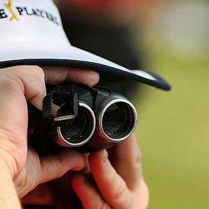 A volunteer keeps a close eye on the jumbo screen at No. 18 showing live action from the rest of the course on Saturday at The Players Championship at TPC Sawgrass.