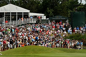 Tiger Woods draws a crowd as he hits his tee shot at No. 18 on Saturday at The Players Championship at TPC Sawgrass.