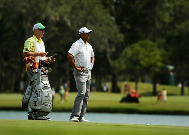 Tiger Woods and his caddie Joe LaCava at No. 18 on Saturday at The Players Championship at TPC Sawgrass. Woods is T34 after the third round.