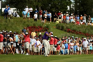Phil Mickelson hits his second shot at No. 18 on Saturday at The Players Championship at TPC Sawgrass.