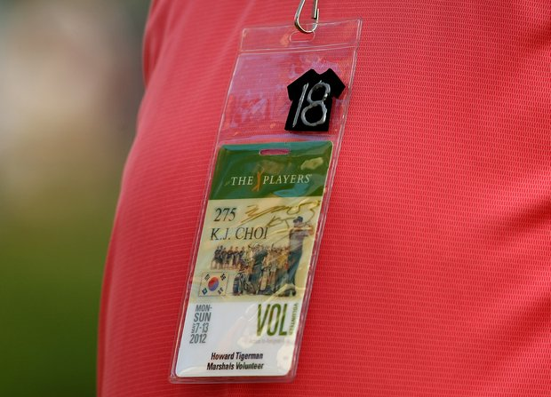 Volunteer Howard Tigerman with his decorated badge for the 18th hole on Saturday at The Players Championship at TPC Sawgrass.