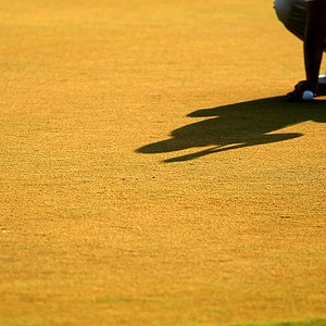 Kevin Na's shadow on the green at No. 18 on Saturday at The Players Championship at TPC Sawgrass.
