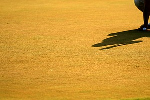 Kevin Na's shadow on the green at No. 18 on Saturday at The Players Championship at TPC Sawgrass.