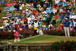 Justin Rose hits out of a greenside bunker at No. 17 during the final round at The Players Championship at TPC Sawgrass.