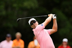 Zach Johnson hits his tee shot at No. 8 during the final round at The Players Championship at TPC Sawgrass.