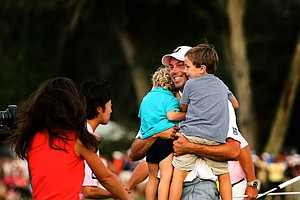 Matt Kuchar celebrates with his family at No. 18 after winning The Players Championship at TPC Sawgrass.