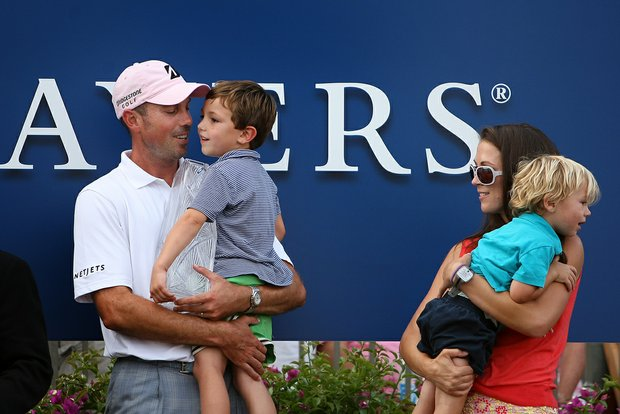 Matt Kuchar with his family, Cameron, 4, wife, Sybi, and son Carson, 2, during the trophy ceremony at The Players Championship at TPC Sawgrass.
