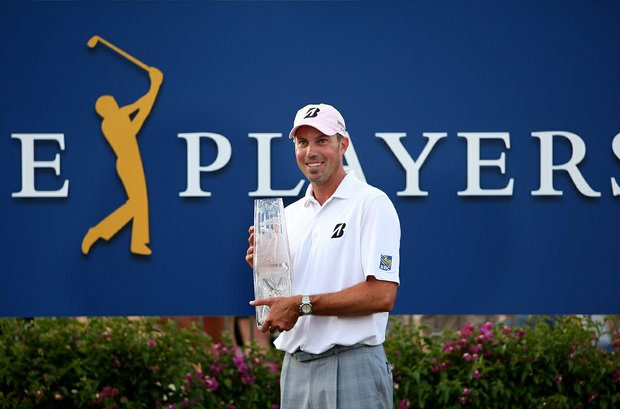 Matt Kuchar poses with the trophy after the final round at The Players Championship at TPC Sawgrass.